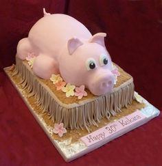 Luau Pig - Sculpted cake body, RKT head and legs.  Fondant grass skirt, gum paste plumeria flowers.:  Cake Central