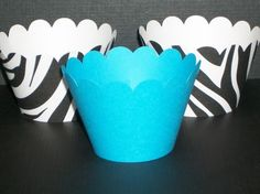 Cute zebra print and aqua cupcake wrappers For more zebra print baby shower ideas for a little boy, see http://www.squidoo.com/zebra-boy-baby-shower