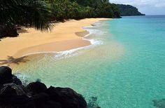 São Tomé and Príncipe (/ˌsaʊ təˈmeɪ ən ˈprɪnsᵻpə/ sow-tə-may-ən prin-si-pə or /ˈprɪnsᵻpeɪ/ prin-si-pay;[7] Portuguese: [sɐ̃w tuˈmɛ i ˈpɾĩsɨpɨ]), officially the Democratic Republic of São Tomé and Príncipe, is a Portuguese-speaking island nation in the Gulf of Guinea, off the western equatorial coast of Central Africa.