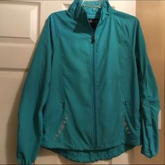 NWT light weight jacket NWT 100 percent polyester full zip front light weight ladies jacket. Teal/Aqua color. Size Medium Kyodan Jackets & Coats