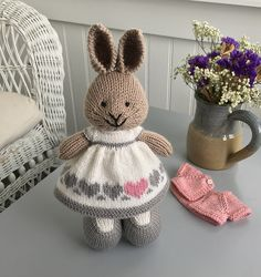 This little dress was knit with a cast on of 96 stitches. To make the three row garter ridge hem, I cast on and knit 4 garter rows on straight needles before knitting in the round beginning with t.Ravelry: Project Gallery for Seasonal dresses Pattern Knitted Doll Patterns, Animal Knitting Patterns, Knitted Dolls, Stuffed Animal Patterns, Knitted Bunnies, Knitted Animals, Crochet Bunny, Knitting For Kids, Free Knitting