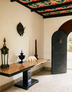 Paloma Picasso: A Fashionable Life,A sleek table contrasts with the ethnic details in the entry.    Read more: Paloma Picasso's Moroccan House Pictures - Paloma Picasso on Interior Design - Harper's BAZAAR