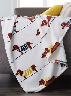 Colorful Warm Dachshund Dog Fleece Throw Blanket. This cute throw blanket makes me happy! It is warm and reminds me of my favorite furbaby. That is a little over four feet X a little over 6 feet of warmth!   eBay!
