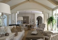 Everything is inspiring and perfectly done in this space. Notice the unique arch separating the family room from the kitchen.