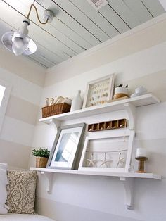 Wall color. Use neutral from bedroom as one color and white as the other to coordinate with crib and changing table