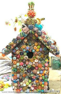 Birdhouse by Kelly Davidson flameworked glass bead birdhouse sculpture.