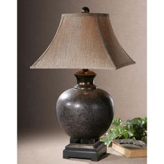mottled rust brown glaze with black accents and dark bronze details define this luxurious table uttermost daviel cinnamon red table lamp   style   45986   red      rh   pinterest