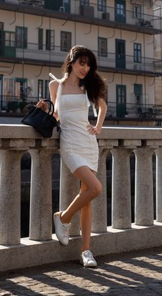 White #minidress with white #sneakers is such a cool and #fashionable #dateoufit idea to wear for any #casualdate this summer. Visit Brunette from Wall Street to find out more details about this #simpledateoutfit now
