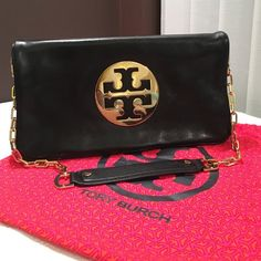 Tory Butch Reva Fold over purse Black with gold hardware fold over purse by Tory Burch.  This purse is in beautiful, excellent condition with no signs of any wear and tear at all.  Used just a handful of times. The strap is removable so can be used as a clutch. Comes with the original dust bag!  Tory Burch Bags Shoulder Bags