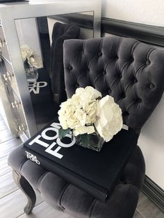 Tufted, gray velvet chair. Tom Ford book