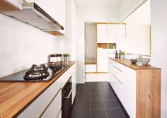 Galley kitchen ideas for HDB homeowners, Lifestyle News - AsiaOne Minimalist House Design, Minimalist Kitchen, Minimalist Style, Small Galley Kitchens, Cool Kitchens, Brown Kitchen Designs, Kitchen Remodeling Companies, Design Your Own Home, Kitchen Cabinet Styles