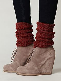 grey booties. red leg warmers. black leggings.