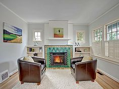Really like fireplaces that have built-ins on either side with small windows above them. I've seen them in many of the types of houses we like recently.