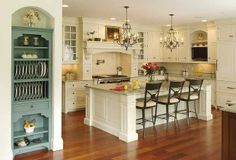 I love the two chandelier's over the island & the pop of color with the built in plate rack.