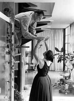 Charles and Ray Eames at home, c. 1970.