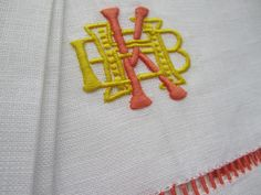 Julia B. A02 Monogram in canary yellow and tangerine  on Aix bordered napkins