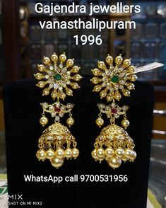 Stunning gold jumkhis studded with multi precious stones. Jumkhis with south sea pearl hangings. Gold Jhumka Earrings, Indian Jewelry Earrings, Gold Earrings Designs, India Jewelry, Gold Jewellery Design, Gold Designs, Emerald Necklace, Gold Pendant, Pendant Jewelry