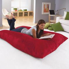 Big Bean Bag pillow. I would be doing exactly this on it. :)
