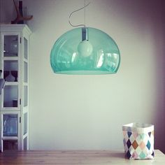 FL/Y by Ferruccio Laviani is one of our favourites http://www.nest.co.uk/product/kartell-fly-suspension-light