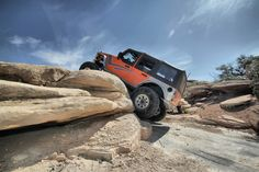 Crawling over the ledge in Moab with a Jeep. #jeep #jeeping #offroad #offroading #wheeling #desert #moab