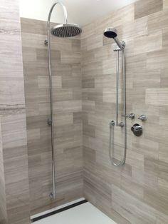 Sleek, Yet Warm Bathroom. Infinity Drain Wedge Wire Linear Channel Drain.