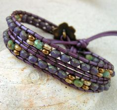 This listing is for a purple and green, leather wrap bracelet. It is a bohemian style bead bracelet with premium Czech glass beads. This is a part of a my Purple and Green Summer Series. The beads on this bracelet are primarily 3 x 5mm, Czech glass beads. The button is available in other colors if you do not care for the antique brass. Please ask about availability if you are interested in silver or gunmetal. If you want a different color of thread (maybe green or purple), please add that…