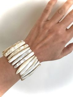 Gorgeous Glowy Mother of Pearl Catches The Light With a Shimmery Opalescent Sheen that Make It a Favorite From Day to Night  Mother of Pearl Stretch Bracelet Stretch Bracelet Fits Most Wrists Bracelet Measures approx 6.75 Unstretched x 2H Natural Shell  Thanks For Shopping! Enter My Shop Here For Lots More Vintage and Handmade Goodies: https://www.etsy.com/shop/WOWTHATSBEAUTIFUL?ref=si_shop  Thanks! WOWTHATSBEAUTIFUL