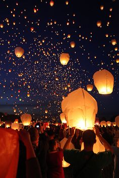 11k Lanterns released, Poznań, PL.   π: It would be fun to write one's dreams/wishes on one and release it.