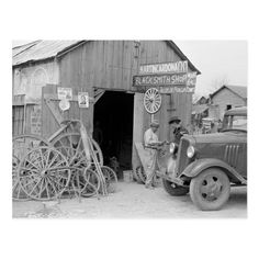 taken in 1939 and shows a Blacksmith Shop in San Antonio, Texas. You can see all the wagon wheels out front. Old Pictures, Old Photos, Vintage Photos, Iconic Photos, Blacksmith Shop, Texas History, Woks, Old Barns, Blacksmithing