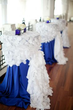 blue and white cocktail tables. But maybe with cobalt blue and hot pink and white...