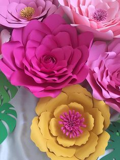 Product Info These gorgeous flowers are custom hand-made pieces, made in the colors of your choice. The flowers are assembled from high quality card stock paper (65LB). Each flower is unique and has an intricately crafted floral center. These luxe, gorgeous blossoms are perfect