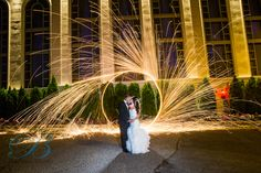 Sparks fly at this wedding - Photo by Bleu Studio
