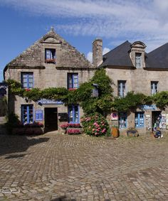 LOCRONON~ A medieval stone village in Brittany. Famous for its beautiful church of Saint Ronan, and it's charming stone houses covered with brightly covered hydrangea. Finistère, Bretagne, France
