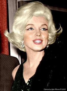 In 1962, The Golden Globe Awards handed out awards for different things then today - that year Marilyn Monroe won the Henrietta Award for being the World's Favorite Star - Rock Hudson presented her statue to her that night - this is Marilyn that night.