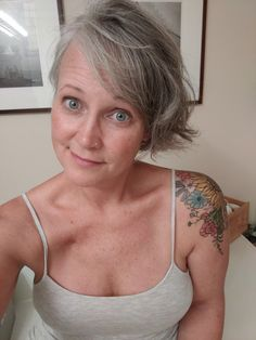 44 and enjoying my silver strands and floral tat! Living with purpose one day at a time... #breastcancersurvivor