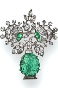 An art deco diamond and emerald brooch, French, circa 1925