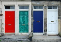 fun front doors in a multi-family building - use color to show your home's personality