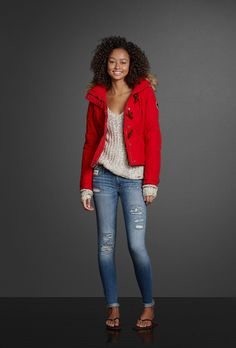 Highlight the pretty shine on a slouchy sweater with the perfect pop of color from a bright winter jacket. Cuff a pair of destroyed jeggings with sparkling shine embellishments to complete the look.