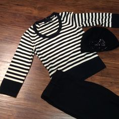 THE LIMITED BLACK AND WHITE SWEATER This is super soft and in excellent condition. 3/4 sleeves The Limited Sweaters