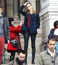 Never off duty: Even just hanging out in casual clothes, Behati still looked every inch the super model
