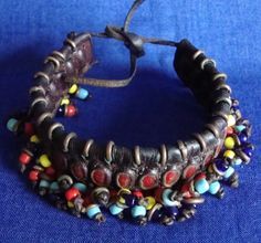 Africa | Anklet from the Wodaabe people.  Leather, brass rings, glass beads. | 30€
