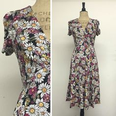 Knee-length 1940s adorable floral dress!! Not at all like the super-short dresses girls wear today.