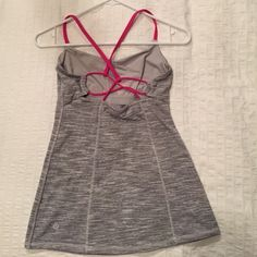 Lululemon strappy top lululemon workout top with built in bra. very comfortable and super cute! lululemon athletica Tops Tank Tops