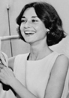 Audrey Hepburn aboard the S.S. Queen Mary leaving New York City, June 1957. Sporting shorter brown hair.