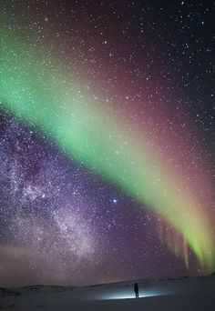 Galaxy and Aurora Borealis over at Arctic Lapland wilderness, Finland