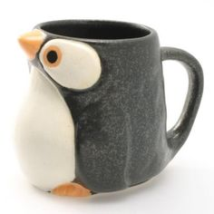 There's something so cute about a cup that stares back at you. Created by Kotobuki Trading Co. this sweet ceramic Penguin Mug is large enough for a cup of coffee and feels comfortable to hold thanks to its puffy penguin body. Coffee Shop, Coffee Cups, Penguin Mug, Tassen Design, Animal Mugs, Clay Cup, Coffee Accessories, Cute Cups, Cool Mugs