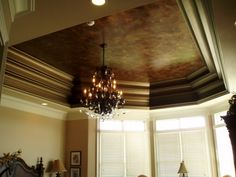 This beautiful tray ceiling has Modern Masters Metallic Blackened Bronze on the deep molding. Finish by Bohemian Spirit Faux Art.