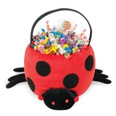 Ladybug Plush Basket  This adorable basket includes a red basket with black polka dots and black fabric handle and is decorated with a cute ladybug face and attached legs.