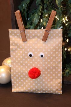 Reindeer Gift Bags with Hot Cocoa packets & candy canes on the inside #DrinkMakeWishBake