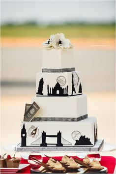 Travel themed wedding cake. Photos by Crystal Stokes photography at the Carolina Aviation Museum http://www.cake-expressions.com